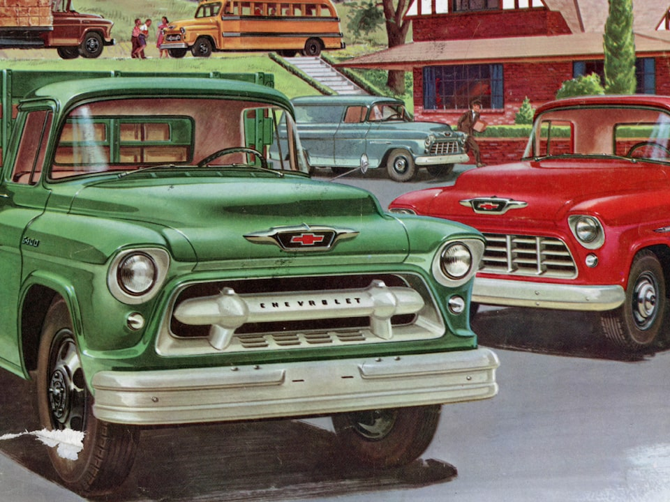 An illustration from the 1955 Task Force Truck brochure of two trucks: a green flatbed with a green rail around the flatbed and a red pickup.