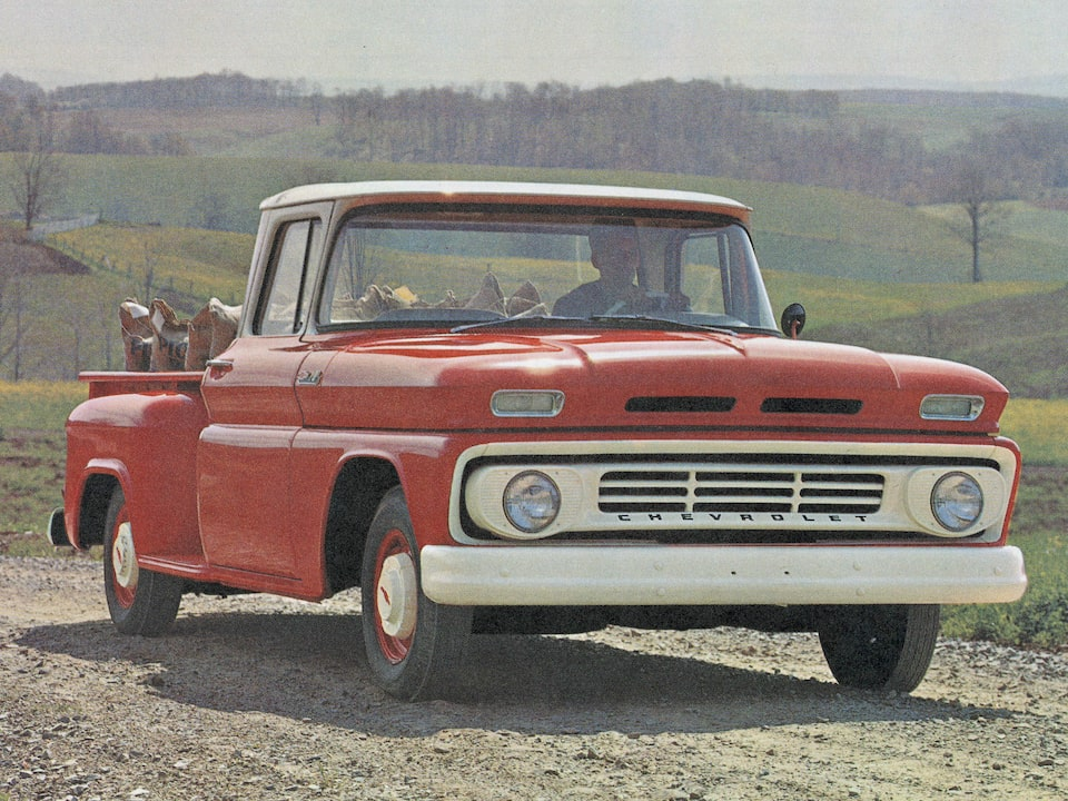 An old photograph of a red Chevy C/K Series pickup from the 1962 C/K brochures.