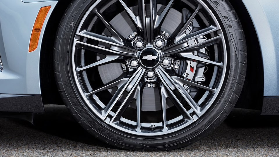 A 10-split-spoke dark graphite-painted forged aluminum wheel on a Camaro.