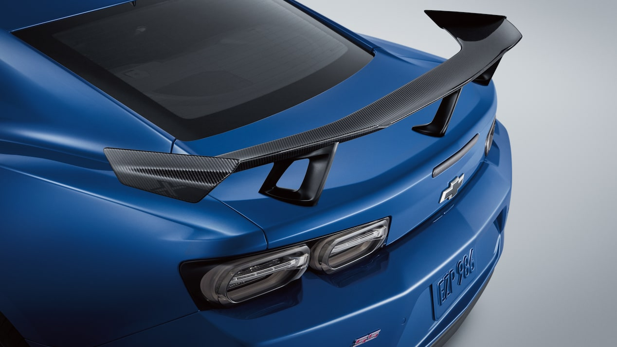 The rear of a Camaro ZL1 1LE Coupe in New Riverside Blue Metallic, with a carbon fiber spoiler mounted on the trunk.