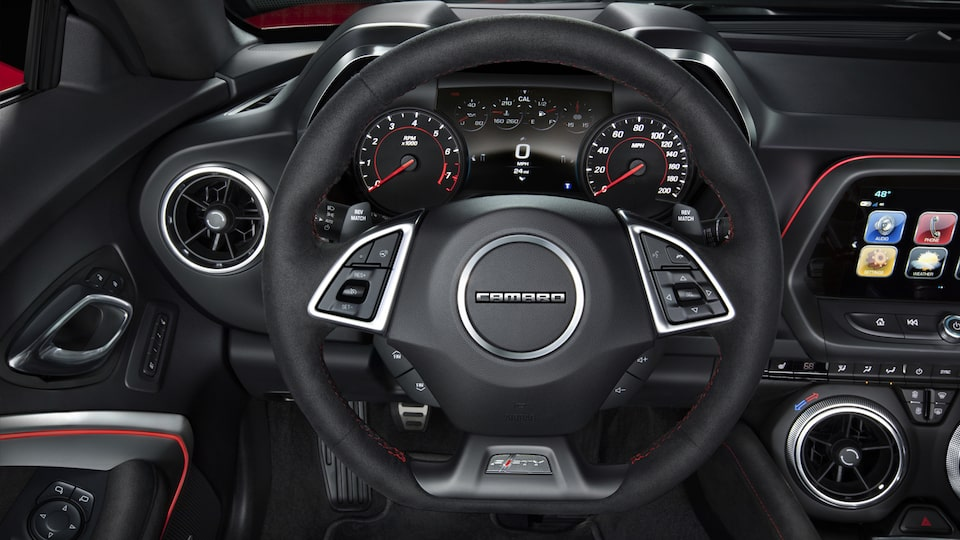 The Camaro's available heated steering wheel, with red stitching.