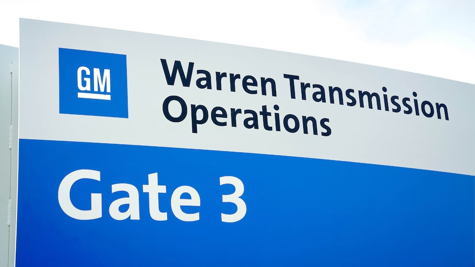 "A building sign that reads ""GM Warren Transmission Operations. Gate 3."""
