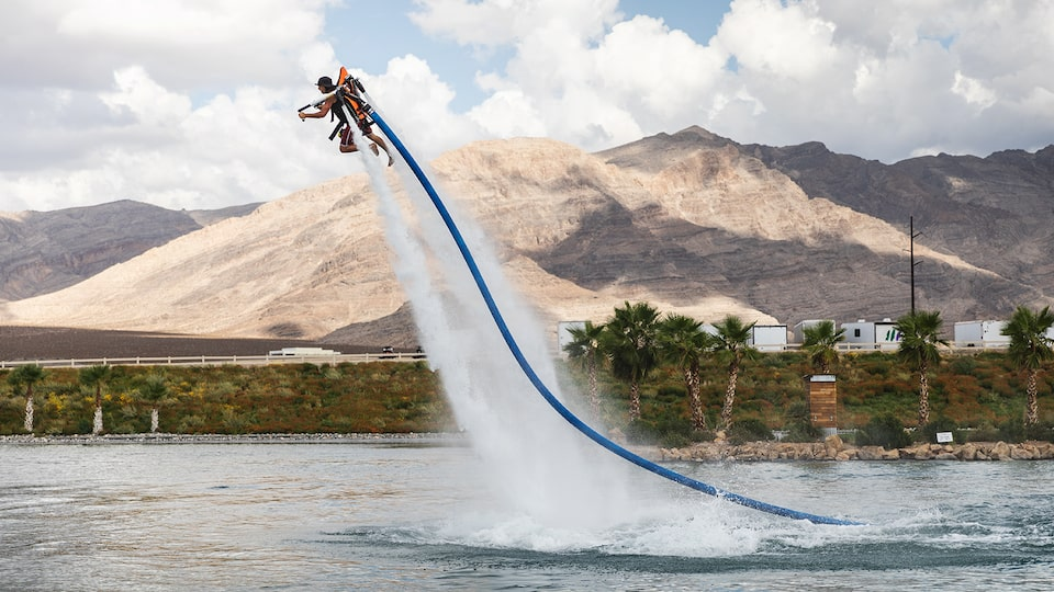 A man lifted up by a water powered jet pack at Spring Mountain Motor Resort and Country Club.