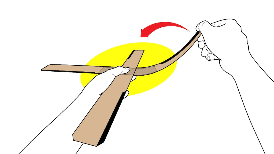 An illustration of someone's hands bending up one blade of a four-blade cardboard boomerang.