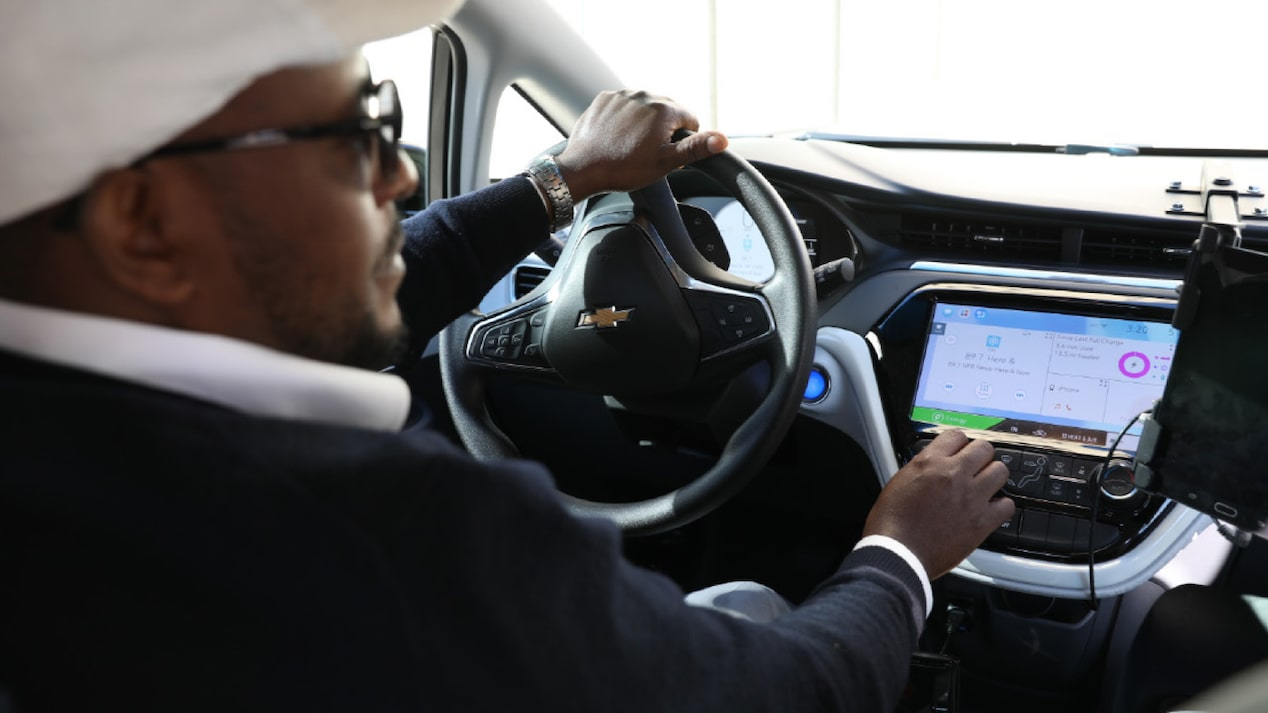 A man behind the wheel of a Chevrolet Bolt EV.