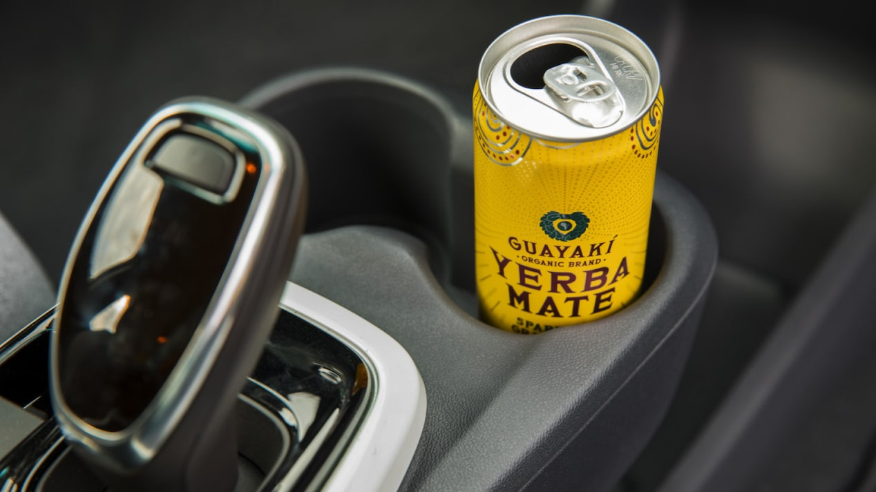 An open can of Yerba Mate beverage in the cup holder of a Chevrolet Bolt EV.
