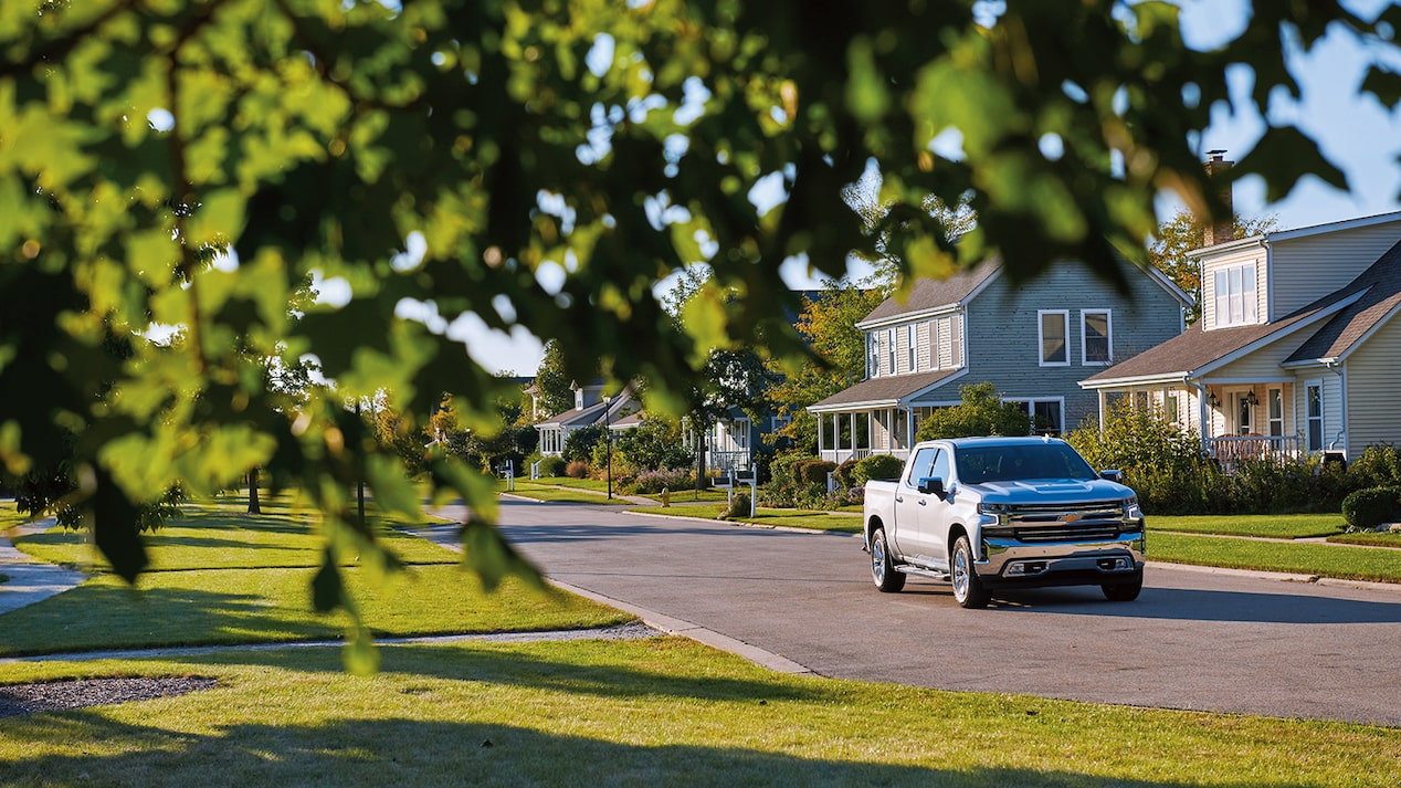 A 2019 Chevy Silverado Crew Cab drives past houses in an agrihood neighborhood.