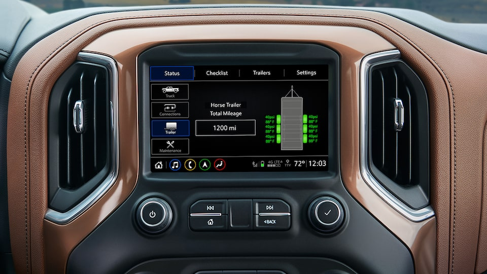 The infotainment screen displays trailer stats as part of the in-vehicle trailering system.