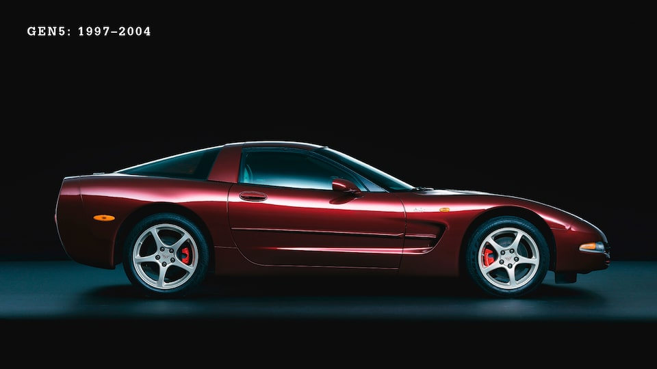 A burgundy Generation 5 (C5, 1997-2004) Corvette from the side against a black background.