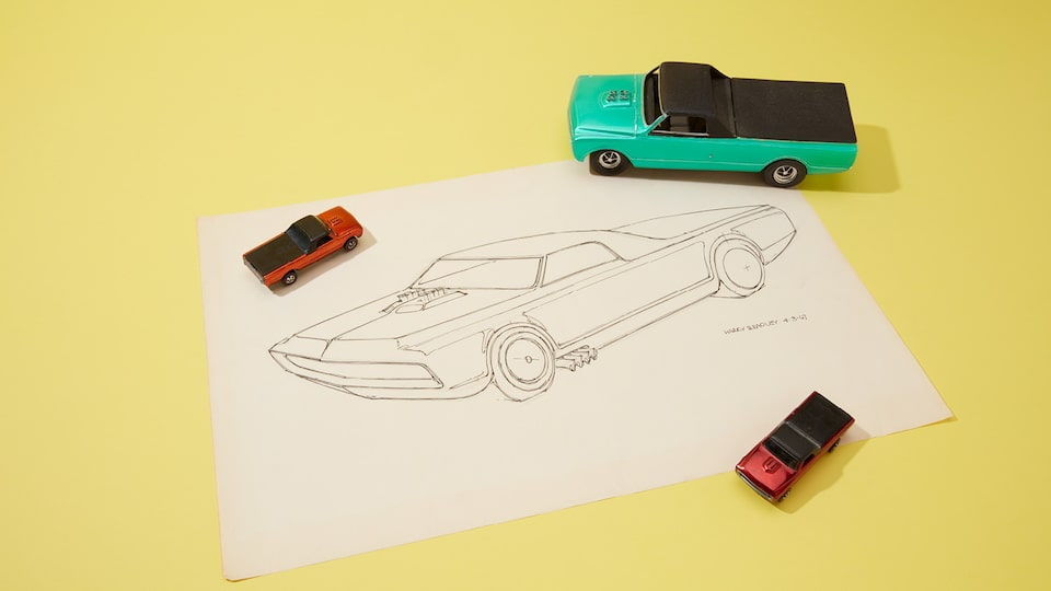 A prototype of an early Hot Wheels with its original line drawing.