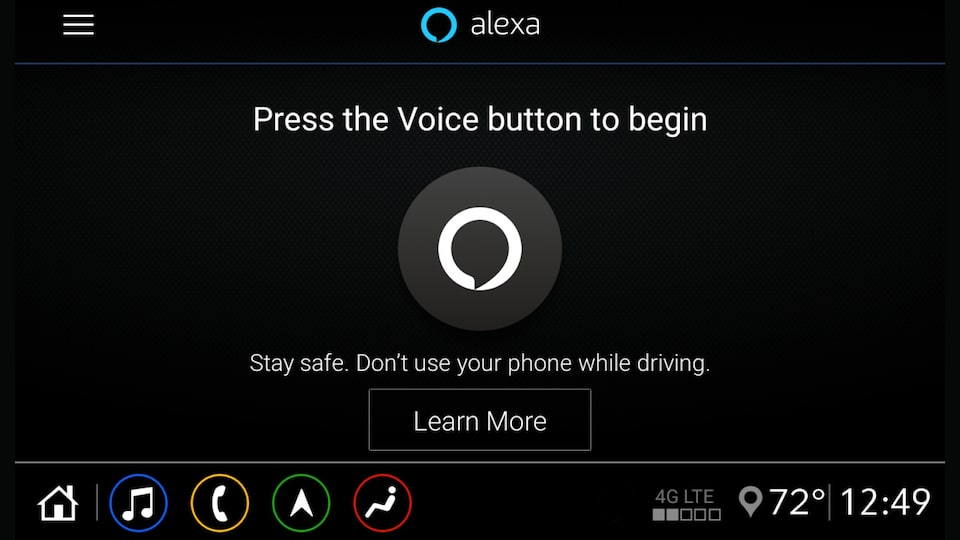 A screenshot of the Alexa Built-in starting screen on the infotainment display in a Chevrolet vehicle. The screenshot shows a button and text that reads: Alexa. Press the voice button to begin. Stay safe. Don't use your phone while driving. Learn more.