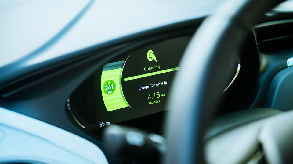 A shot of the dashboard of a Bolt EV showing that it is charging and the time until the charge is complete.