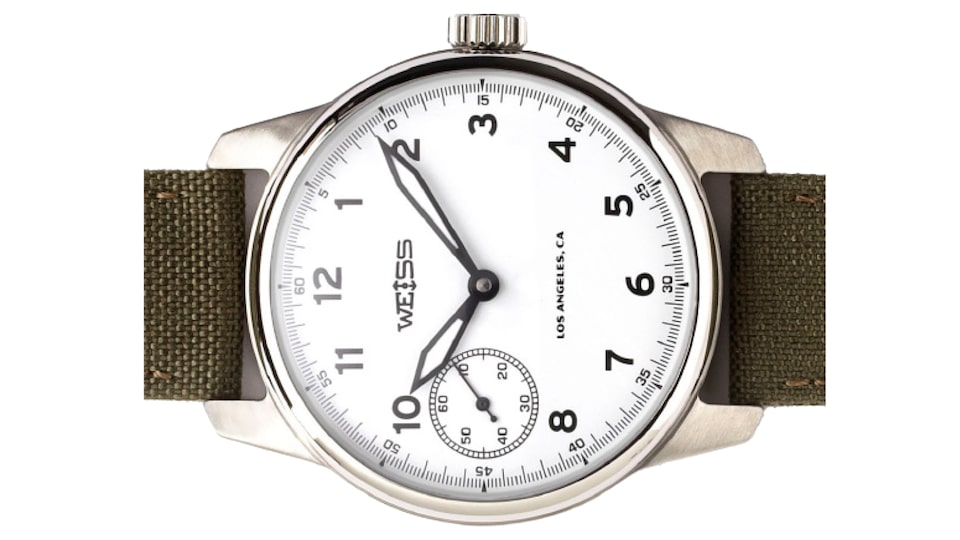 A closeup of a Weiss watch.