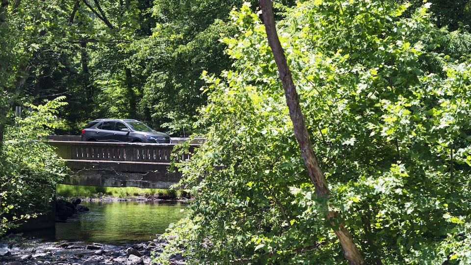 A Chevrolet Equinox crosses a river on a bridge.