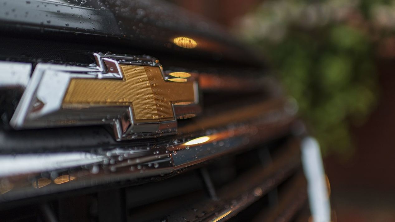 A close-up photo of the Chevrolet logo on the Equinox's grille.