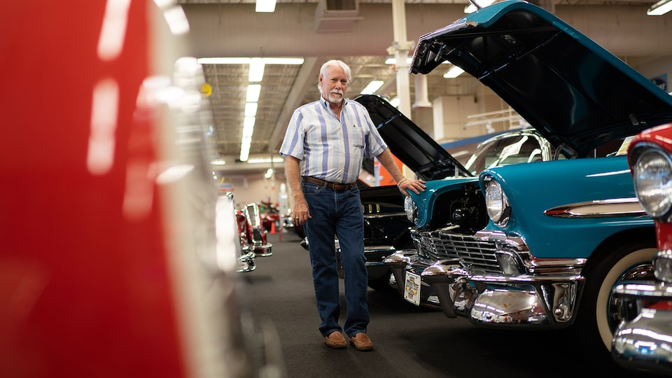 Rick Trewory stands in front of a classic Chevy Bel Air in his collection.