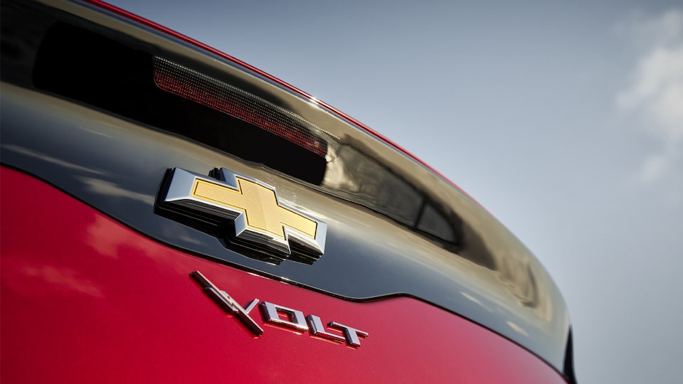 The Chevy and Volt emblems on the rear of a Volt.