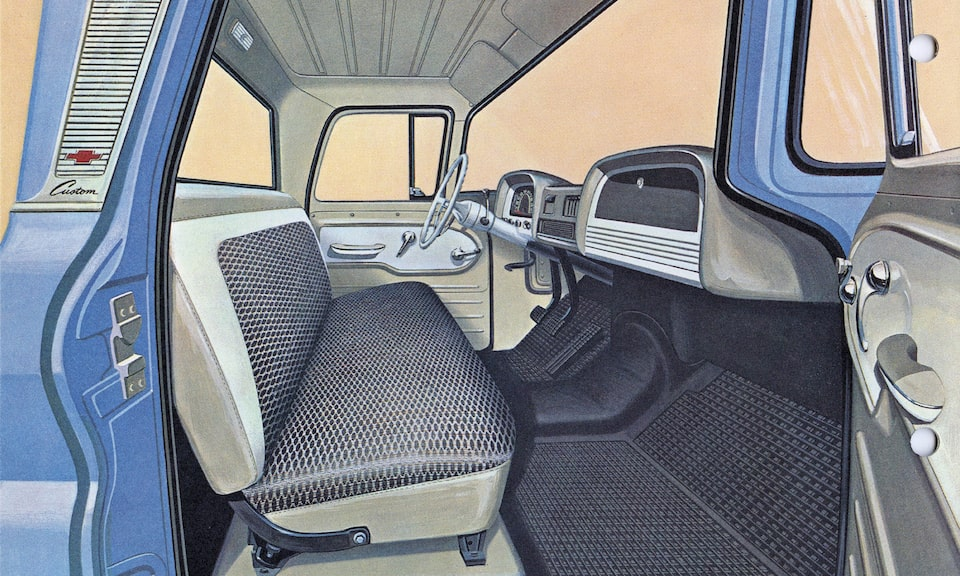 An illustration from the 1962 C/K Series truck brochure showing the interior of the truck's cab.