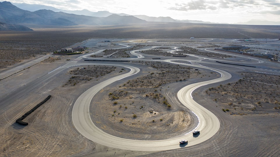 An aerial shot of the curvaceous racetrack at Spring Mountain Country Club in the Nevada desert.