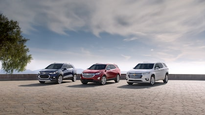 Chevrolet Trax, Equinox and Traverse crossovers parked next to each other.
