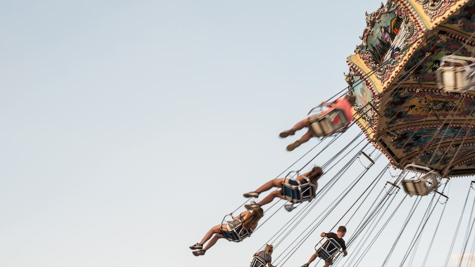 State fair attendees enjoy swinging through the summer sky.