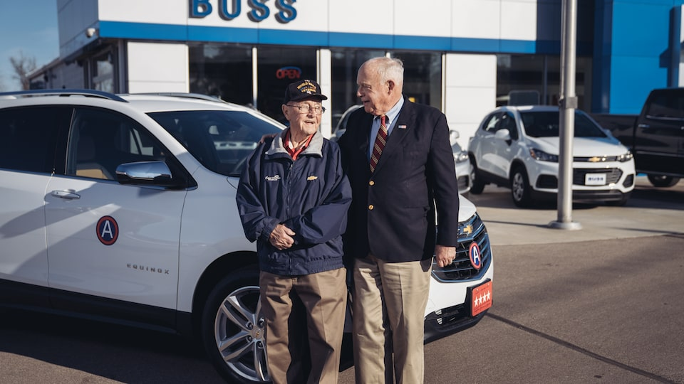 Reuben Schaetzel with George Patton Waters in front of the 2018 Chevy Equinox Waters bought from Schaetzel. The Equinox has a four-star license plate and Gen. George Patton's division medallion.