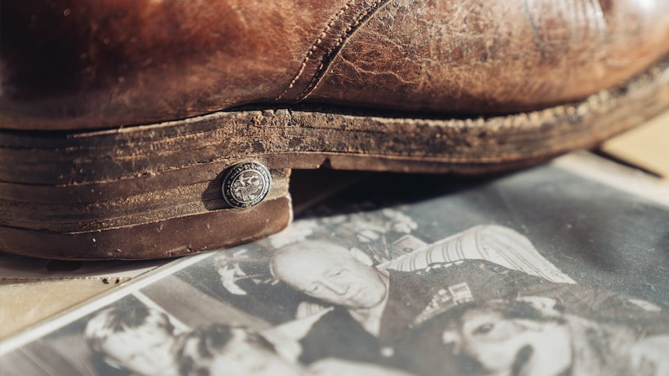 Gen. George Patton's boot and an old photo of George Patton Waters as a child with Gen. Patton.