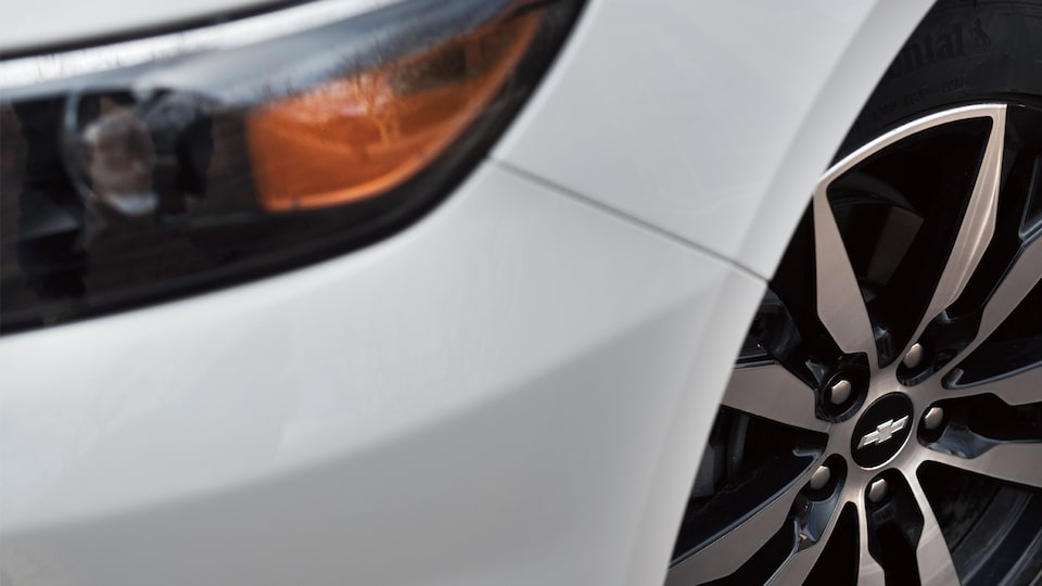 Close-up shot of the Chevrolet Malibu's headlight and front feel.