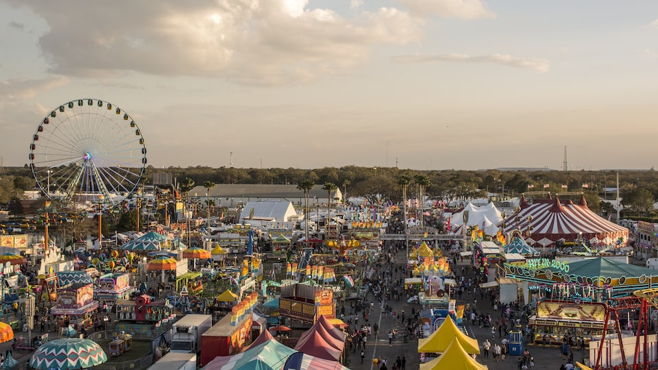 A faraway photograph depicting colorful rides and concession stands.