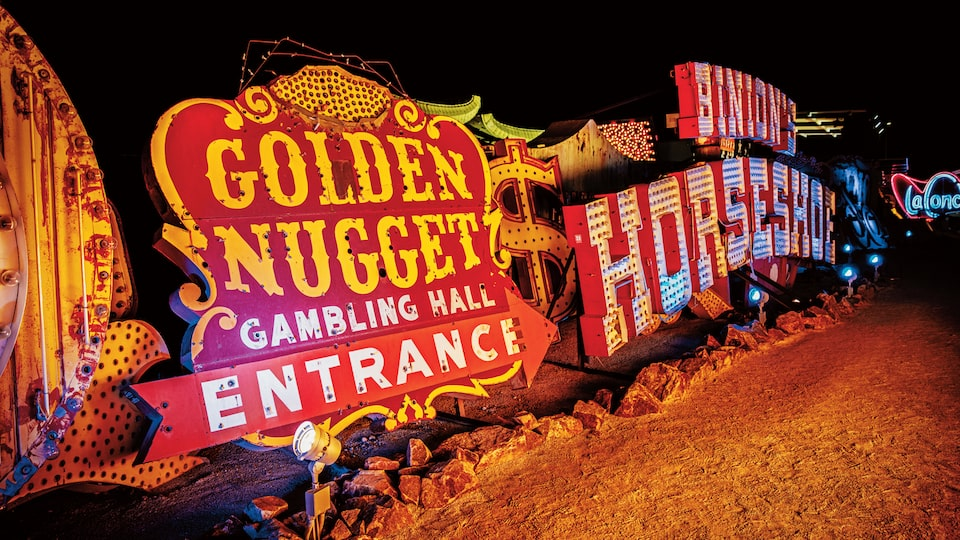 Several old Las Vegas signs lying on the ground at the Neon Museum, including the Golden Nugget and Binion's Horseshoe.