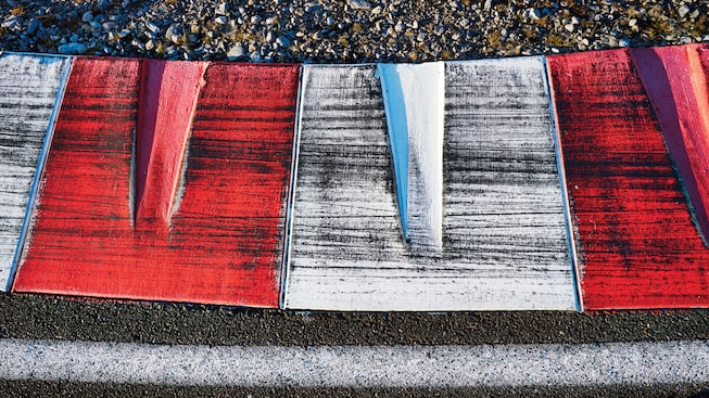 The red-and-white-striped track edge.
