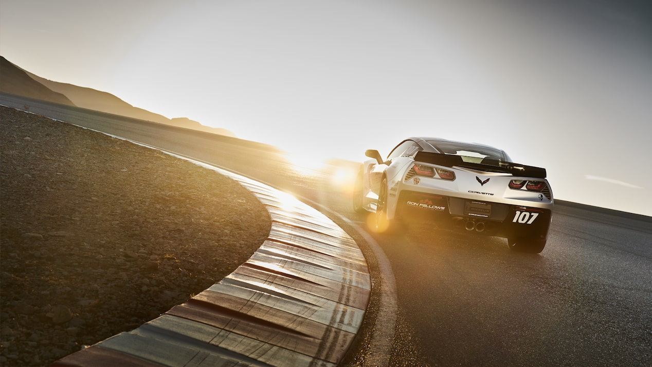 The rear of a Corvette going down the track.