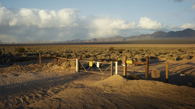 Aside from a fence, the line between Yates Well Road in Nipton, California, and the desert is indistinguishable.