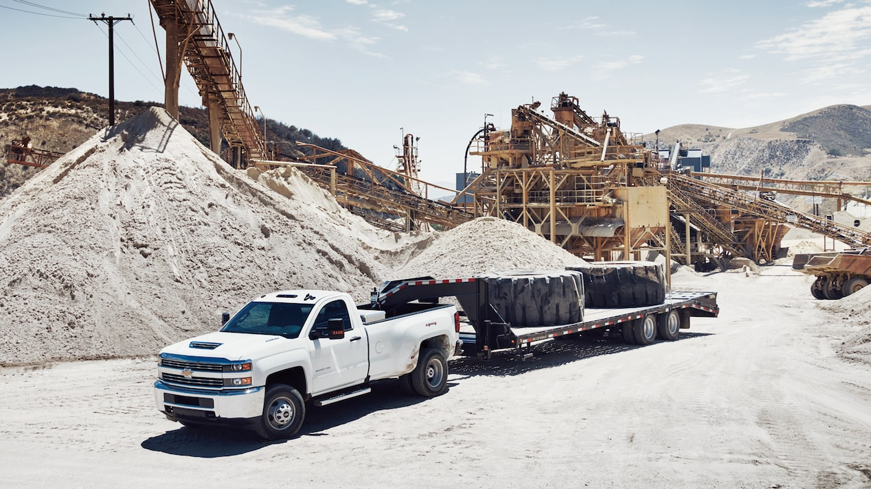 A Chevy Silverado HD towing on a job site.