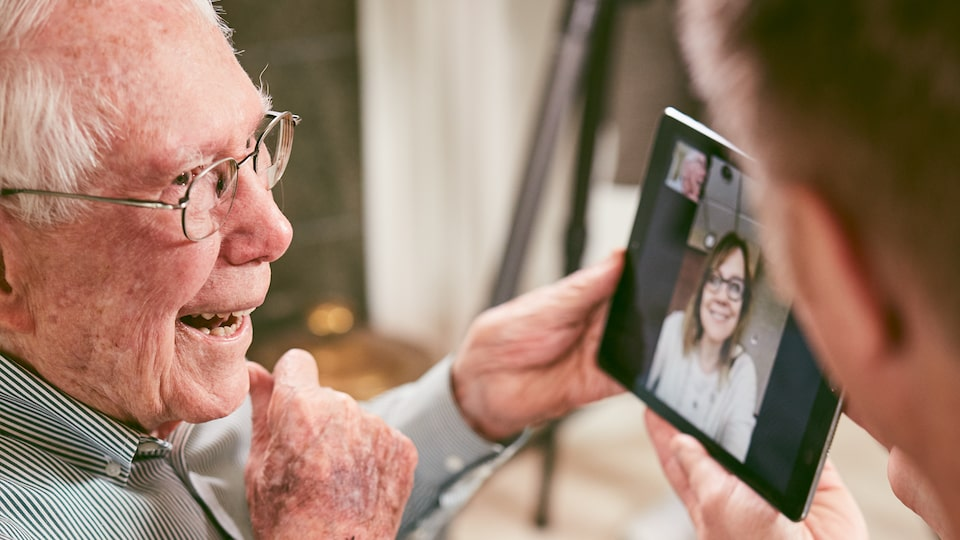 Paul Hitch takes a video call from General Motors CEO Mary Barra on a tablet.