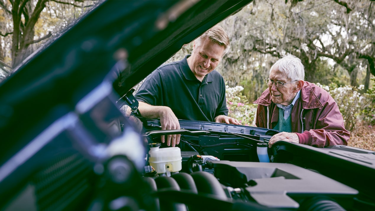 Eric Stanczak and Paul Hitch look at the engine of a Chevy Silverado Centennial Edition.