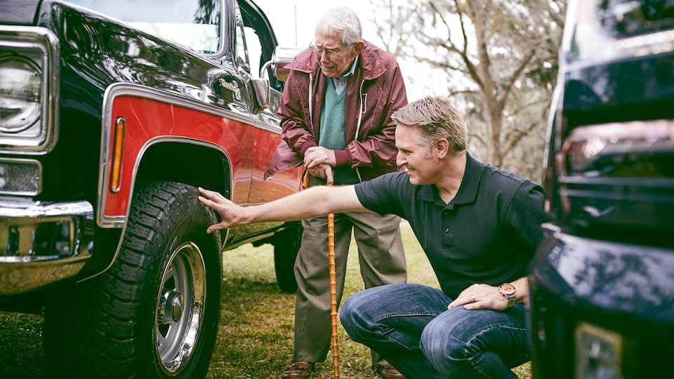 Eric Stanczak and Paul Hitch take a close look at a classic Chevy truck Hitch helped engineer.
