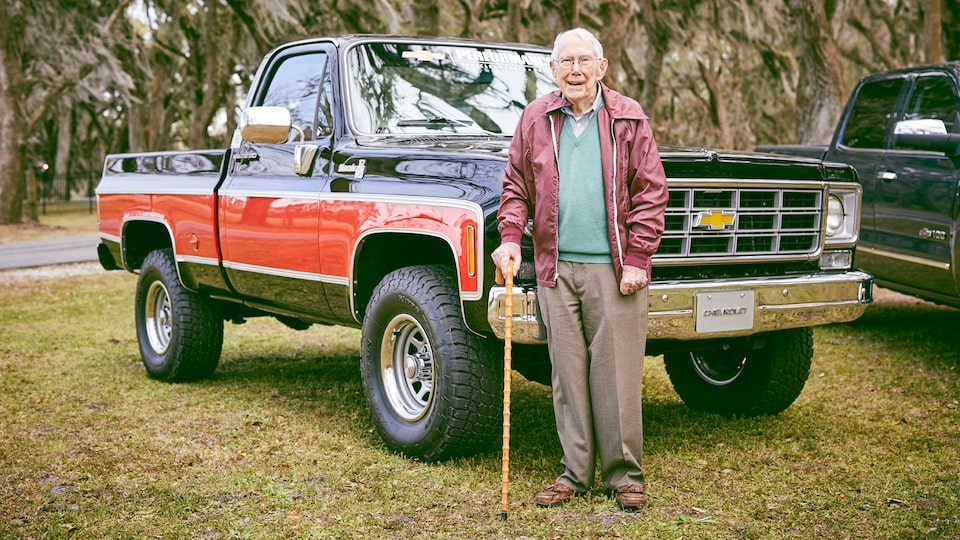 Paul Hitch stands in front of a '70s-era Chevy pickup he and his team helped engineer.
