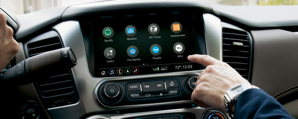 Passenger Uses In-Vehicle Chevy Infotainment System