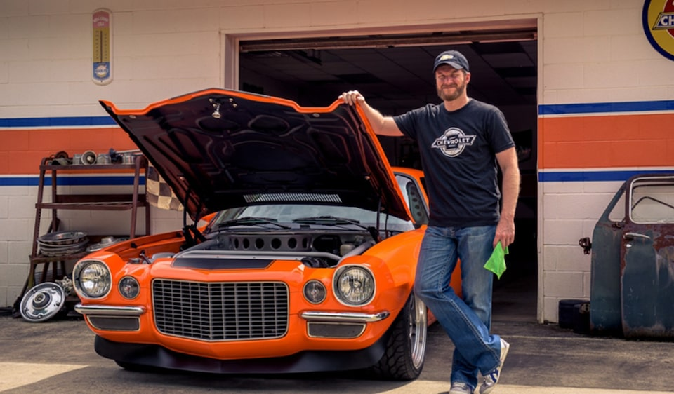 Dale Jr with his orange 1972 Chevy Camaro