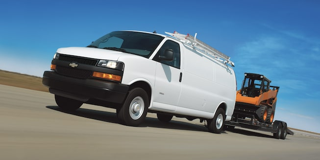 2019 Chevrolet Express Cargo Van: Driver side view of towing a trailer