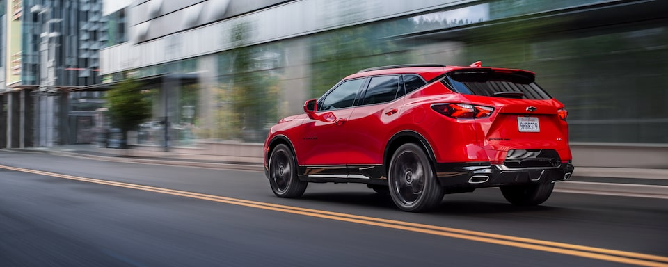 2020 Chevy Blazer Sporty SUV: driving down the street rear view