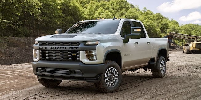2020 Chevy All-New Silverado HD Truck: corner view stands on a dirt road
