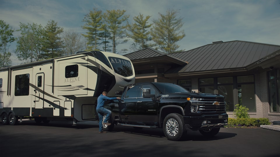 All-New Silverado HD Truck: trailer being towed in front of a house video still
