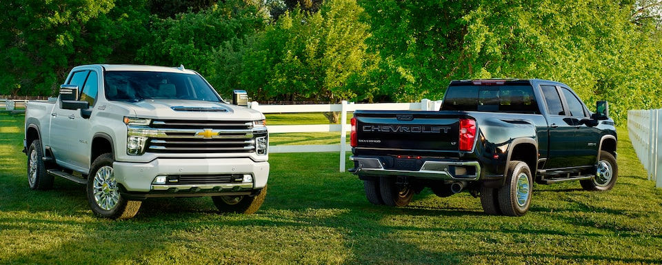Two 2020 Chevy All-New Silverado HD Trucks: front & rear view
