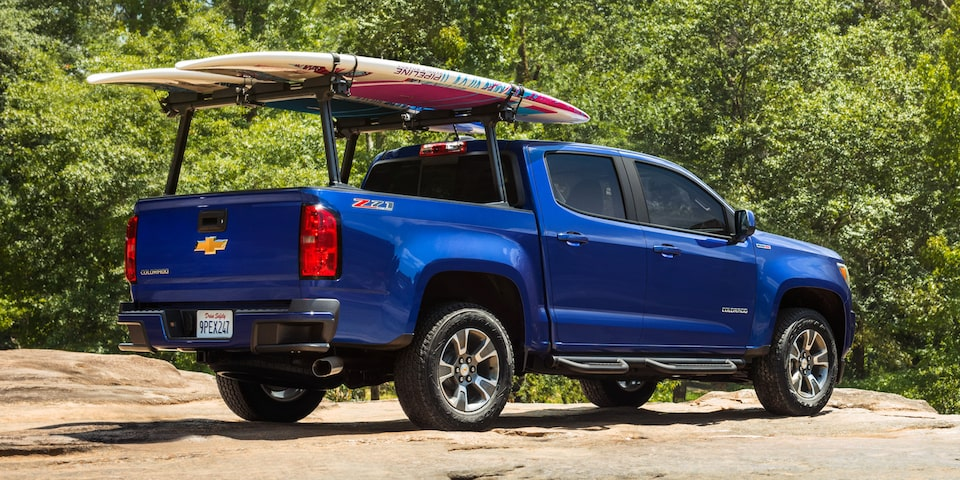 2020 Chevrolet Colorado Mid-Size Truck with rear cargo rack and surf boards